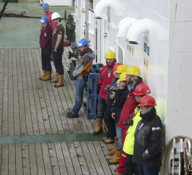Marine scientists standing on the deck of a research ship
